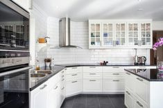 BODBYN - Google Search; dark floors and counters...white subway tile...traditional cabinet...like the sink but not the hood