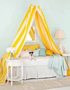 DIY Canopy Bed  This easy project makes smart use of an embroidery hoop and a pair of ready-made curtains. this idea will do a world of good for brightening up our basement guest room!