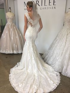 Morilee by Madeline Gardner Monet Wedding Dress. A stunning statement illusion back and flattering V Neck Front accent the lace appliquéd fit and flare skirt. Stunning for a classic Vineyard wedding.