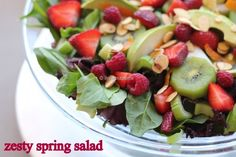 Zesty Spring Salad - all my favorites, almonds (or pecans), kiwis, celery, raspberries, strawberries, avocado, pear, mandarin oranges
