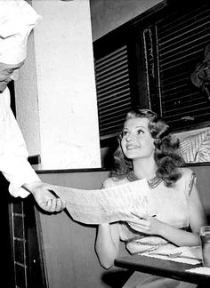 Rita Hayworth takes a break from the filming of 'Down to Earth' and taking advice from Chef Emil ~ Oct 13, 1946