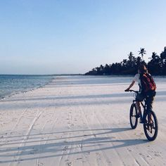 #Zanzibar: The #sand is soft, and the surface is hard, like flour. This #island #paradise is a top destination after a #safari trip in the nearby parks. Photo taken by Joanna Skladanek. #comissionculture #bicycle #Africa #beach #travel