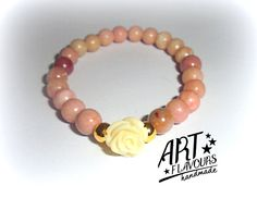 Ethereal, insanely lovely bracelet with rhodonite 8mm, adorned with white rose. Fascinatingly alluring