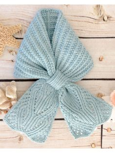 """This sweet ascot has a pull-through slip, so there's no tying necessary! Both ends are done in an intricate, twisted stitch lace pattern. Knit with approximately 300 yds of #4 worsted-weight yarn at a gauge of 22 sts and 28 rows per 4"""" using U.S..."""