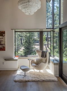 Bancroft residence, California by Jack Hawkins Architects | Arne Jacobsen egg chair and flokati rug.