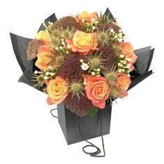 £40.00 - Turner Bouquet. Reminiscent of the stunning sunset in #Turner's Fighting Temeraire, this striking bouquet includes beautiful Miss Piggy Roses, with orange fading to dusky pink outer petals. Contrasted with the subtle blue Eryngium and deep purple Trachelium. The white Bouvardia softens this bouquet like the mists and the ghostly Temeraire in the painting. #ValentinesDay