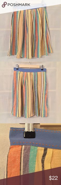 """Odille Anthropologie Pale Bright striped skirt EUC. No stains or holes. Odille (Anthropologie) """"Pale Bright"""" orange, yellow, black, and blue vertical striped a-line skirt. Grosgrain ribbon waistband. Pockets! Unlined. 55% linen, 45% cotton; a woven fabric like a chambray. Measurements (flat): waist 14"""", hip 20"""", length 20"""". 6"""" invisible side zip with tab-and-bar closure. Machine wash gentle. Style 20622452. No trades. Anthropologie Skirts A-Line or Full"""