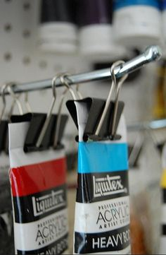 Use binder clips on peg boards to hold tubes of acrylic paint / Melly Kay