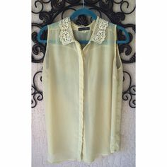 Pale yellow blouse with lace collar Love the lace detail on the collar of this top! Primark Tops Button Down Shirts