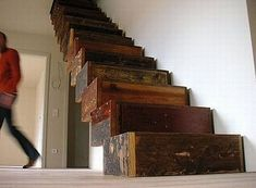 Jan Korbes's Garbage Architecture used the remnants of the antique floor and construction wood from the Schloss Wiesenburg to create this impressive staircase. Designed in the 'shape of add-on boxes supporting itself as a constructed, empty beam', it has the lightness of a floating staircase with the texture and history of the castle itself. Built in cooperation with Judith van der Meer.