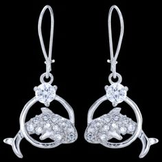Silver earrings, zirconia, dolphin Silver earrings, zirconia, Ag 925/1000 - sterling silver. With stone (Cubic zirconia). Dangle earrings with leverbacks. Rhodium-plated. Playful dolphin, studded with 10+1 zircons, is jumping through the circle. Dimensions approx. 22x14x3mm excluding enclosure. Price per pair.