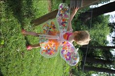 clear contact paper + flower petals = fairy wings!