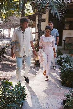 Elizabeth Taylor and Richard Burton on location in Puerto Vallarta, Mexico, while Burton was filming The Night of the Iguana, directed by John Huston. Stanley Baker follows the couple. Photo: Archive Photos / Getty Images