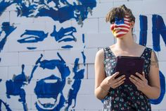 An activist with her face painted in an American and German flag. - Odd Andersen/AFP/Getty Images