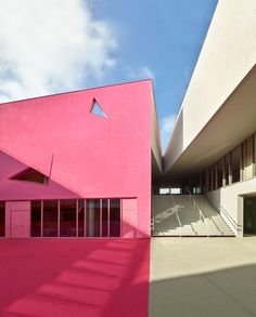 The niches in the facade and courtyard are designed to help bring light and fresh air through this school in Colombes