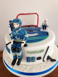 Vancouver Canucks Ice Hockey Cake - with the exception of the two team mascot Lego figures, everything else is 100% edible.
