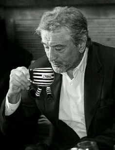"""Robert De Niro drinking from a Santino & Co Walking Pottery Cup THE PRISONER """"ON THE RUN"""". Did you know Rob was once quoted as saying """"Not everyone is going to like me or my favourite Funny Cup, and I say, I don't give a $;;!$!"""". Thanks Mr De Niro, all our Walking Pottery is hand-made and hand-painted in limited edition production runs. Designed and created by Santino Dipiazza exclusively for Santino & Co, making today's collectables.... tomorrow's antiques."""