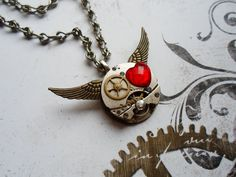 Elegant and extravagant necklace in steampunk style made of old watch movement (recycled) and silver wings, decorated with red heart shaped stone. Chain is massive, lenght is about 43 cm. The recycled part of the necklace is just a watch movement. Wing Necklace, Washer Necklace, Pendant Necklace, Steampunk Wings, Steampunk Fashion, Old Watches, Silver Wings, Bubble Envelopes, Psychobilly