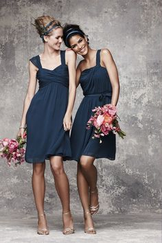 Dark blue dresses for the bridesmaids. The colors in the bouquets are great.