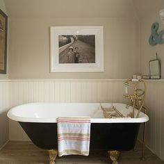 Quintessential country style - tongue & groove panelling and cast iron freestanding bath