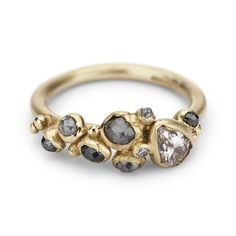 Rose cut grey diamonds and pear-shaped champagne diamond in yellow gold. Handmade in London, this is a unique engagement ring for an alternative bride.