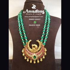 Exotic! More like out of this world!Add some hue and personality to your outfit with this beautiful Emerald Mala. Beautiful emerald mala with chaandbali gold large pendant. Pendant studded with precious stones and gold ball hangings. Whatsapp : 099660 00001 / 098483 99866. 15 May 2018