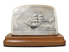 """Searching Arctic Whaler"" Black and white scrimshaw on ancient mammoth tusk ivory by David Smith. A masterpiece of Smith's signature stipple style of scrimshaw, this stately whaler glides through the calm waters searching for its quarry. The entire surface  is heavily worked by Smith. The iceberg borders are brilliant. The back of the ivory shows the rare blue bark, prized by all who know mammoth ivory.  Size: 4""W x 2""D x 2 3/4""H Price: $1,100.00 -- on ScrimshawGallery.com #scrimshaw"