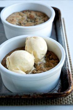 Deep dish chocolate chip cookies with melty vanilla ice cream
