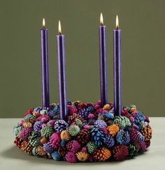 ~ Advent Wreath ~ I love the colors that the pine cones have been sprayed....