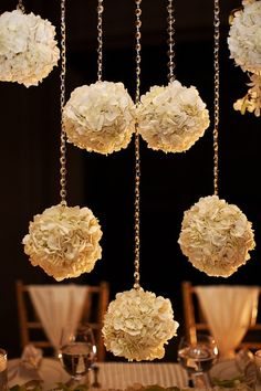 pretty hanging flowers make a dramatic statement at a wedding reception.