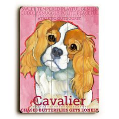 This Cavalier II wood sign by Artist Ursula Dodge is sure to bring style to your space and a smile on your face.