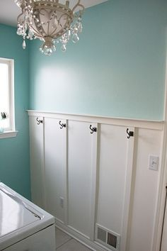 a higher chair rail with hooks. love it for this laundry room idea, or would also be great in a bathroom. by corrine