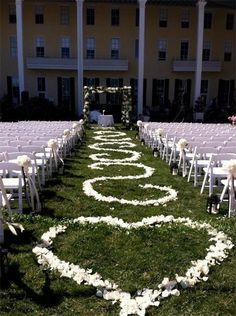 rose petal swirls decorate the isle