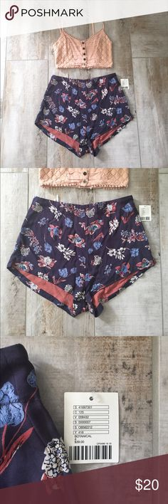 Urban outfitters Kimchi Blue floral shorts Urban outfitters floral shorts. Size 4. Used. Zipper to the side. Garter to the back. Feel free to offer! Urban Outfitters Shorts