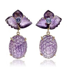 "Russell TRUSSO - Carved Amethyst & Sapphire Floral Earrings. 18-karat yellow Gold. Amethyst 56 ctw., Sapphire 6 ctw. Overall length: 1 5/8"". Available in pierced or clip. Designed by Russell Trusso. •$3,250"
