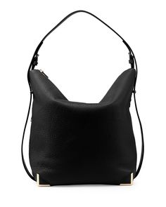 "Alexander Wang pebbled leather hobo bag. Rose gold hardware. Flat shoulder strap extends down body of bag. Slouchy zip top closure. Reinforced corners. 12.6""H x 16""W x 6.5""D. ""Prisma"" is imported."