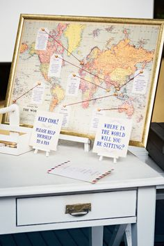 Guest seating chart for travel inspired wedding. Just switch out world for San Francisco map.