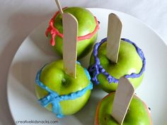 Teenage Mutant NInja Turtle Party Apples (what if you dipped them in white chocolate dyed green, then a pink turtle mask because it a girl party)