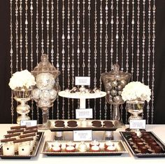 A lavish side table with nibblies is another place to extend your color themes. Consider reusing your christmas baubles presented in vases - a cheap way to bump up your decorations while adding class and sparkle. #brown #tan #reception #weddings