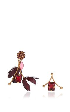 These eye-catching mismatched **Marni** earrings feature bold geometric and floral-inspired constructions with an edge.