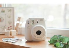 Fuji Instax Mini 8 film camera. Available in white, pink, blue, yellow and black. Buy now from EyeCandys.com with FREE Shipping! http://www.eyecandys.com/fujifilm-instax-cameras/