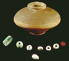 The ancient bead pot and its contents once cleaned up and put on display.  Be sure to check out http://www.harappa.com/indus2/120.html for more information about this fascinating archeological find.