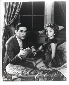 Shirley Temple with Jack Hays, a creator of the Baby Burlesk series, 1933. Shirley really didn't like this man, and you can tell it by the look on her face.