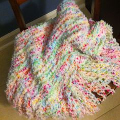 Baby blanket made on a round loom.