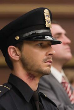 As much as I dislike Shia lebouf he does look really good in a police uniform