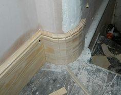 Curved skirting board corner
