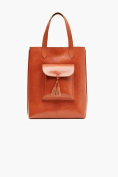 Leather Tote Bag made of vegetable tanned Italian cowhide. Small front pocket with magnetic closure and leather tassel. Inside leather pocket.