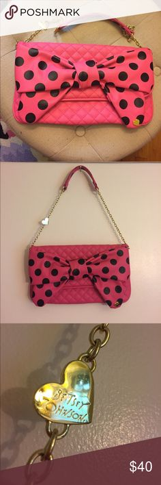 "🌈Final price!🌈NWOT Betsey Johnson polka dot bag! Never used, adorable shoulder bag by Betsey Johnson! Super fun and girly! Measures approx 13"" wide and slightly less than 7.5"" in height. Has a magnetic clasp closure, with a pocket also on the back. Only flaw I can see are a few teeny marks on the BJ heart on chain. Not at all noticeable. Vegan materials. Tags: Barbie, girly, pink bow, Minnie Mouse, polka dots Betsey Johnson Bags Shoulder Bags"