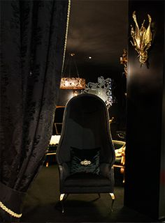 @koket with Drapesse Chair at Maison et Objet 2014 http://www.bykoket.com/projects.php Black and Gold, that's luxury at its best, that lamp though is just marvelous.