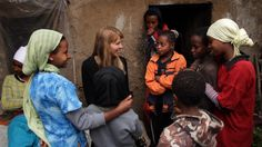 Beth is with Zinet's sisters and friends in front of Zinet's house during filming of Mother: Caring for 7 Billion.  (Ethiopia)